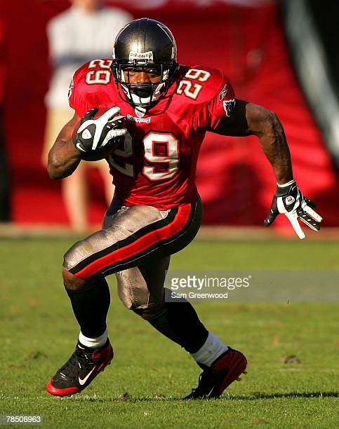 Michael Bennett of the Tampa Buccaneers runs for yardage against the Atlanta Falcons at Raymond James Stadium on December 16 2007 in Tampa Florida...