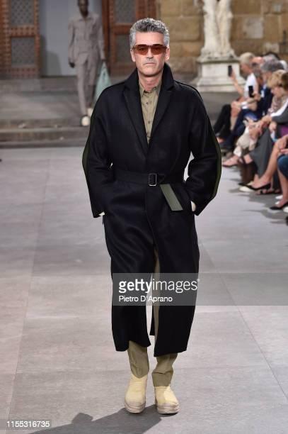 Michael Berger-Sandhofer walks the runway at the Salvatore Ferragamo fashion show in Piazza della Signoria during Pitti Immagine Uomo 96 on June 11,...