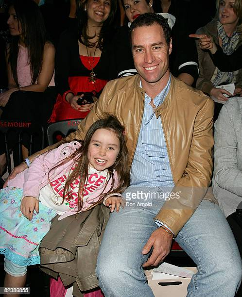 Michael Bevan and his daughter sit front row at Alex Perry's Ready to Wear bridal collection / Safari Princess Spring/Summer collection on the...