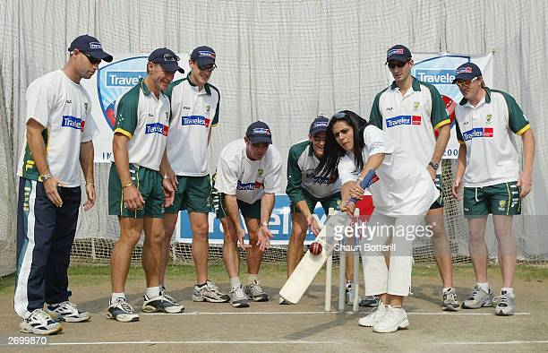 Michael Bevan Andy Bichel Nathan Bracken Jimmy Maher Adam Gilchrist Michael Kasprowicz and Brad Williams of Australia with Indian TV cricket...
