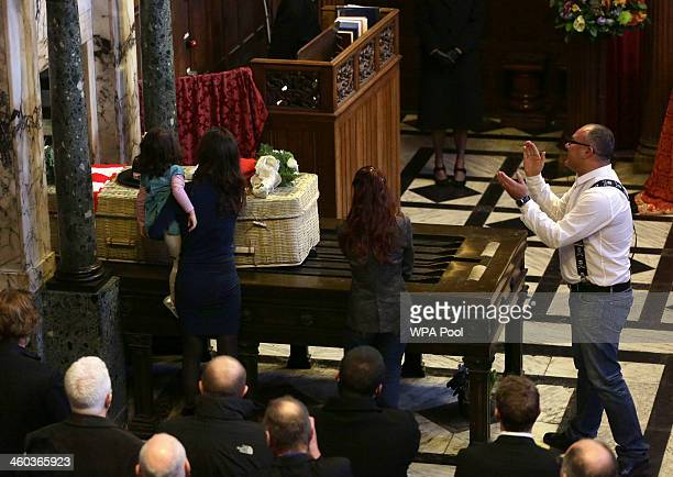 Michael Biggs and his family pay their last respects to his father Ronnie Biggs during his funeral service during the funeral for the 'Great Train...