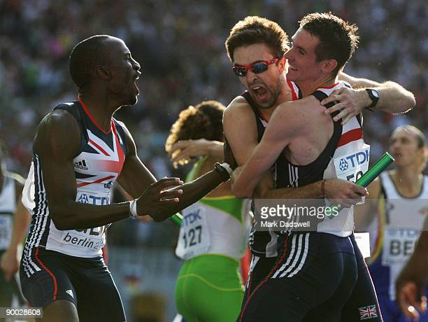 Michael Bingham Martyn Rooney and Robert Tobin of Great Britain Northern Ireland celebrate winning the silver medal in the men's 4x400 Metres Relay...