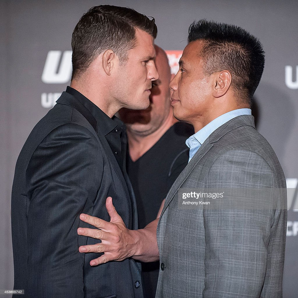 Michael Bisping and Cung Le at a face offs event during the Macao UFC Fight Night Press Conference at the Four Season Hotel on August 20, 2014 in Hong Kong.