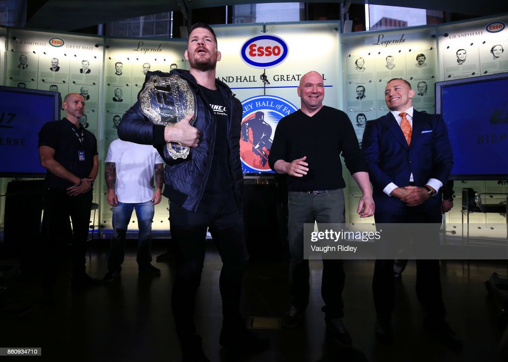 Michael Bisping and Georges St-Pierre face off following the UFC 217 press conference with Dana White at the Hockey Hall of Fame on October 13, 2017 in Toronto, Canada.