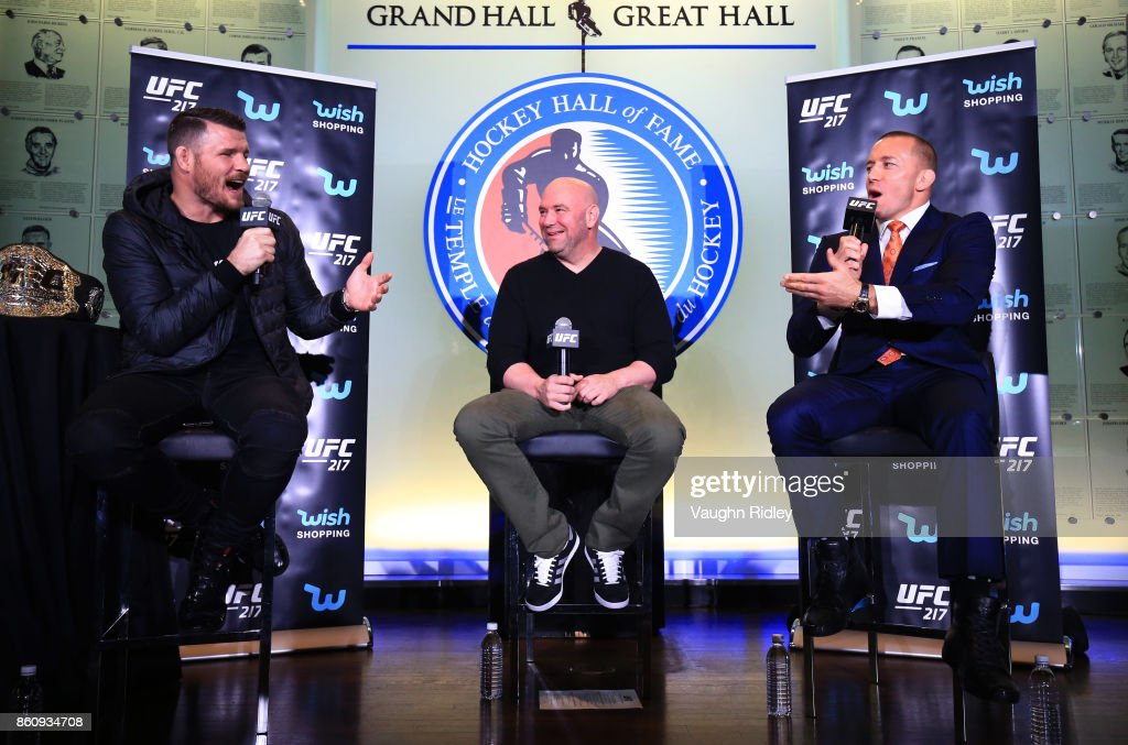 Michael Bisping and Georges St-Pierre speak to eachother during the UFC 217 press conference with Dana White at the Hockey Hall of Fame on October 13, 2017 in Toronto, Canada.