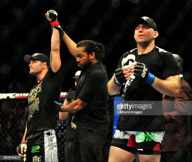 Michael Bisping has his arm raised in victory after beating Alan Belcher after a middleweight bout during UFC 159 Jones v Sonnen at Prudential Center...
