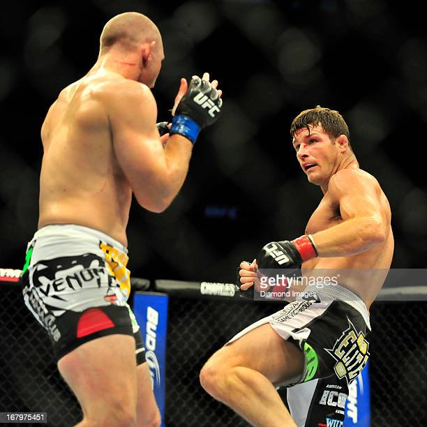 Michael Bisping kicks Alan Belcher during a middleweight bout during UFC 159 Jones v Sonnen at Prudential Center in Newark New Jersey