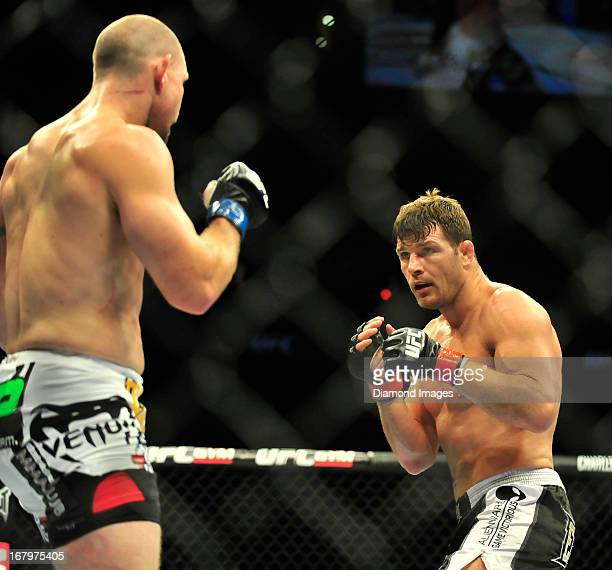 Michael Bisping looks for an opening to throw a punch at Alan Belcher during a middleweight bout during UFC 159 Jones v Sonnen at Prudential Center...