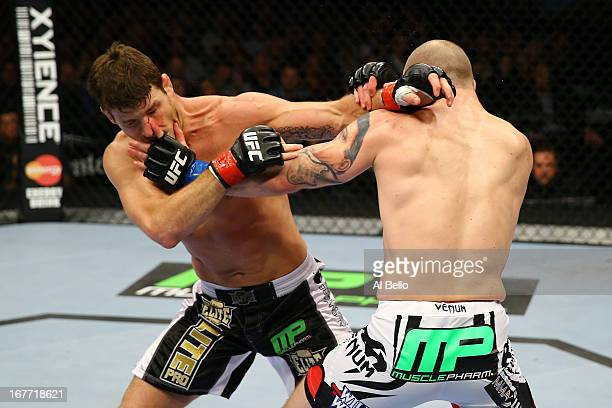 Michael Bisping of England and Alan Belcher exchange punches in their middleweight bout during the UFC 159 event at the Prudential Center on April 27...