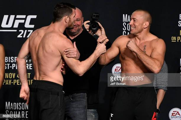 Michael Bisping of England and Georges StPierre of Canada face off during the UFC 217 weighin inside Madison Square Garden on November 3 2017 in New...