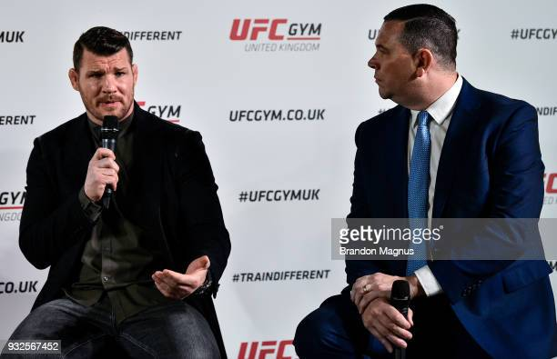 Michael Bisping of England and Joe Long speak to the media during the UFC Gym Press Conference in Glaziers Hall on March 15 2018 in London England