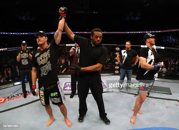 Michael Bisping of England is announced winner by unanimous decision against Alan Belcher in their middleweight bout during the UFC 159 event at the...