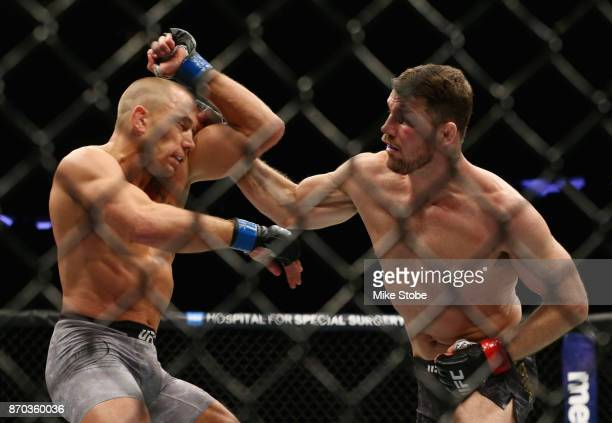 Michael Bisping of England lands a punch against Georges StPierre of Canada in their UFC middleweight championship bout during the UFC 217 event at...