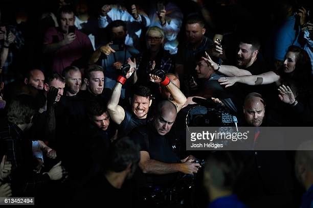Michael Bisping of England prepares to enter the Octagon before facing Dan Henderson in their UFC middleweight championship bout during the UFC 204...