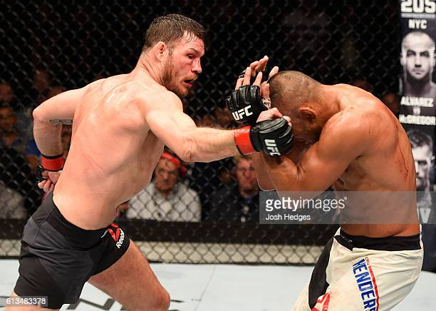 Michael Bisping of England punches Dan Henderson in their UFC middleweight championship bout during the UFC 204 Fight Night at the Manchester Evening...