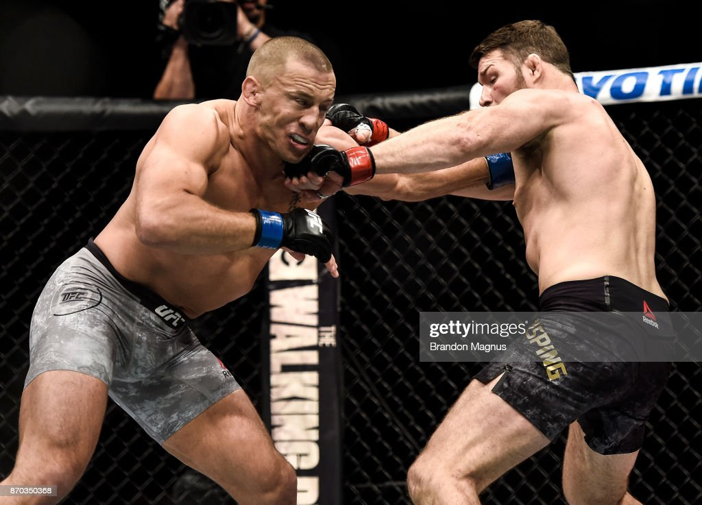 Michael Bisping of England punches Georges St-Pierre of Canada in their UFC middleweight championship bout during the UFC 217 event inside Madison Square Garden on November 4, 2017 in New York City.