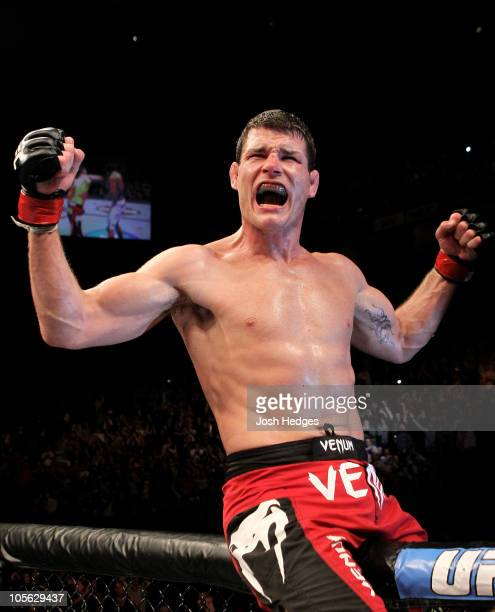 Michael Bisping of Great Britain celebrates victory against Yoshihiro Akiyama of Japan during their UFC middleweight bout at the O2 Arena on October...