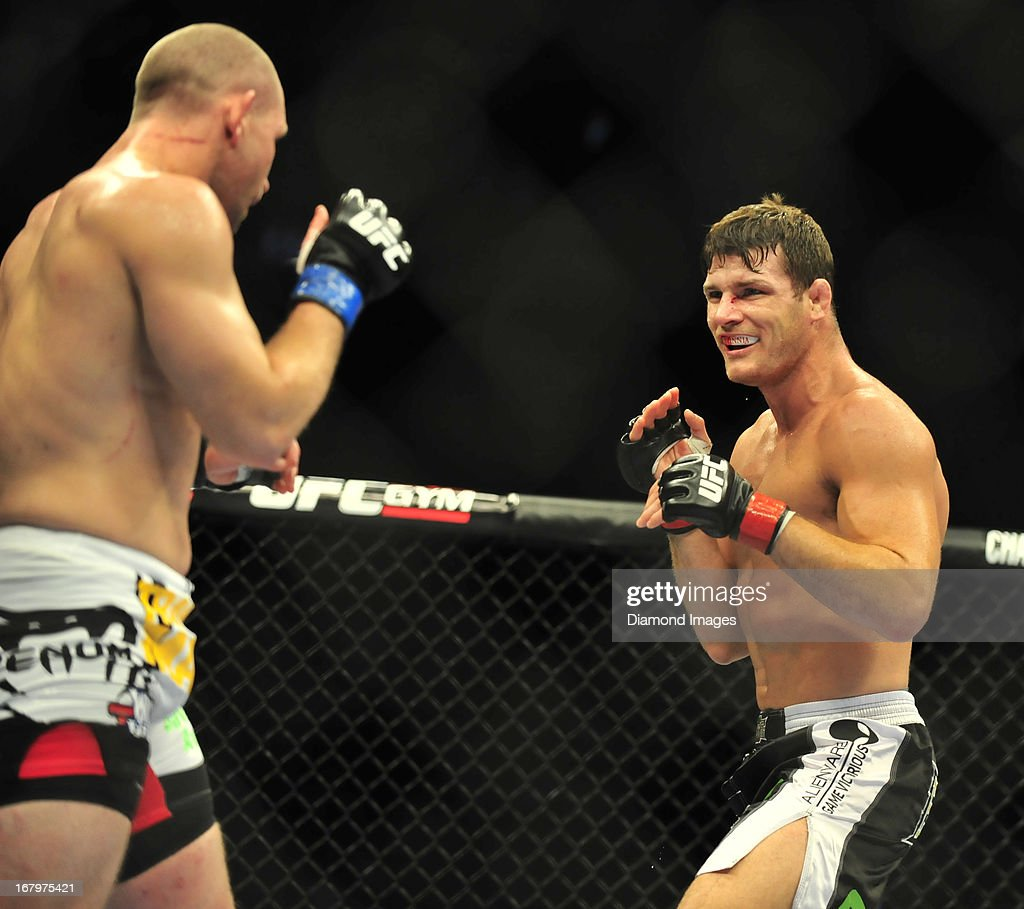 Michael Bisping smiles while looking for an opening to throw a punch at Alan Belcher during UFC 159 Jones v. Sonnen at Prudential Center in Newark, New Jersey.