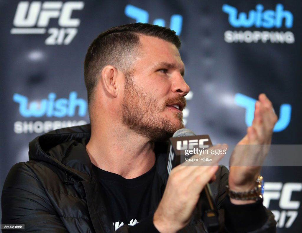 Michael Bisping speaks to the media during the UFC 217 press conference with Dana White and Georges St-Pierre at the Hockey Hall of Fame on October 13, 2017 in Toronto, Canada.