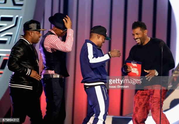 Michael Bivins Ronnie DeVoe and Ricky Bell of Bell Biv DeVoe accept the Soul Train Certified Award from Deon Cole onstage at the 2017 Soul Train...