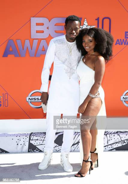 Michael Blackson and Georgia Reign attend the 2018 BET Awards at Microsoft Theater on June 24 2018 in Los Angeles California