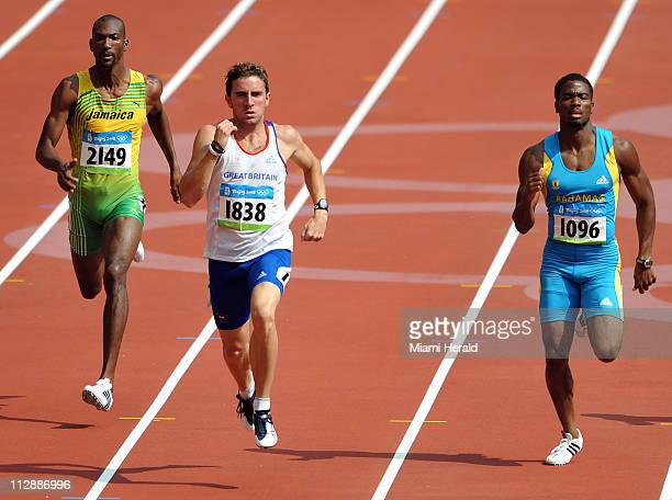Michael Blackwood of Jamaica, left, Andrew Steele of Great Britain, center, and Michael Mathieu of the Bahamas compete in 400-meter qualifying in the...