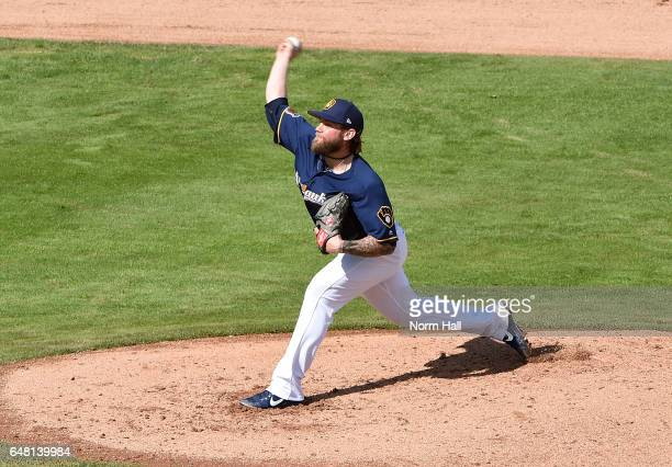 Michael Blazek of the Milwaukee Brewers delivers a pitch against the Kansas City Royals at Maryvale Baseball Park on February 28 2017 in Phoenix...