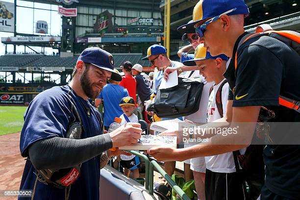 Michael Blazek of the Milwaukee Brewers signs autographs for fans before the game against the Pittsburgh Pirates at Miller Park on July 31 2016 in...