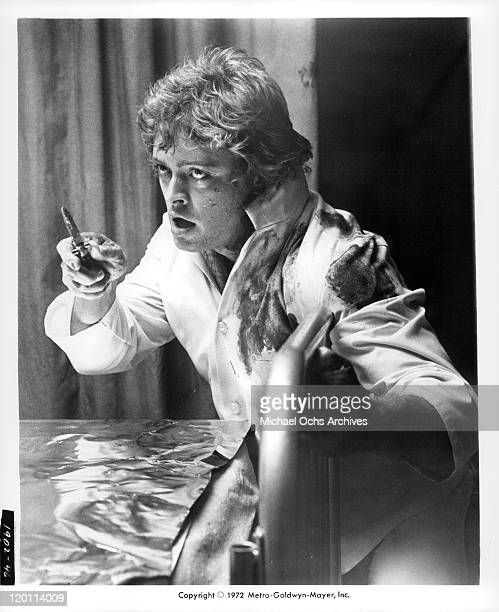 Michael Blodgett with knife in a scene from the film 'The Carey Treatment' 1972