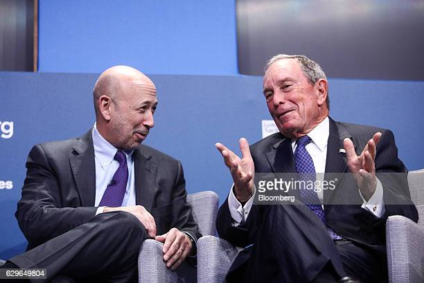 Michael Bloomberg founder of Bloomberg LP gestures as Lloyd Blankfein chairman and chief executive officer of Goldman Sachs Group Inc reacts during a...