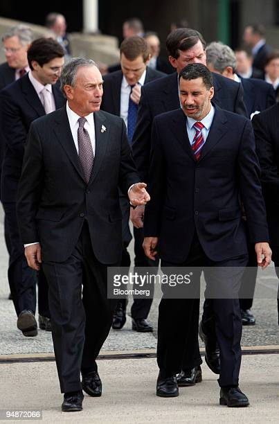 Michael Bloomberg, mayor of New York, left, speaks with David Paterson, governor of New York, upon their arrival for a news conference near the West...