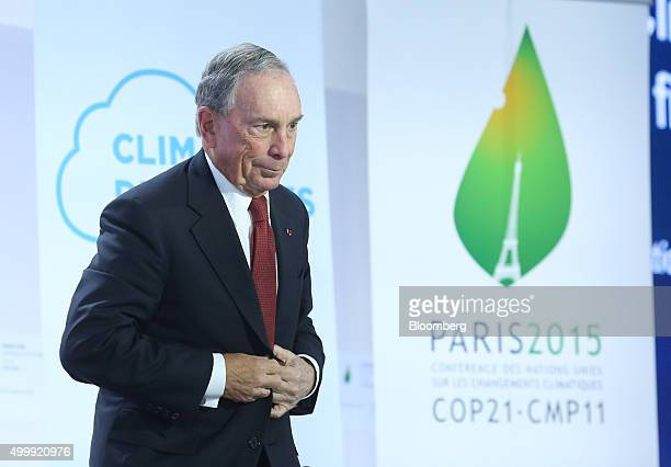 Michael Bloomberg United Nations special envoy for cities and climate change and founder of Bloomberg LP buttons his jacket during a news conference...