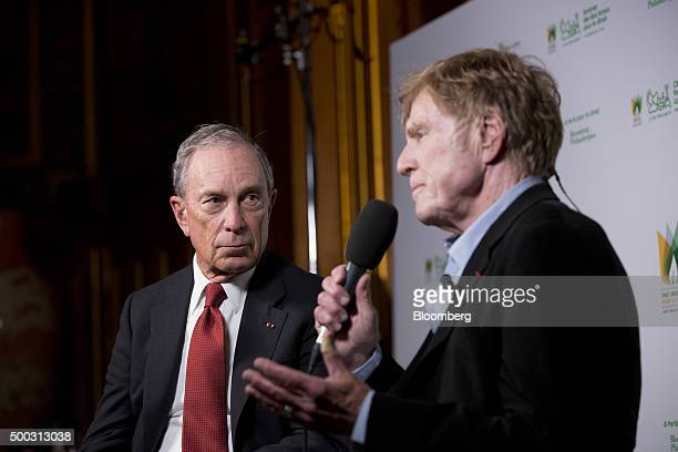 Michael Bloomberg United Nations special envoy for cities and climate change and founder of Bloomberg LP left listens as Robert Redford actor speaks...