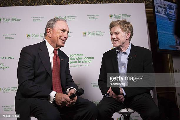 Michael Bloomberg, United Nations special envoy for cities and climate change and founder of Bloomberg LP, left, and Robert Redford, actor, react...