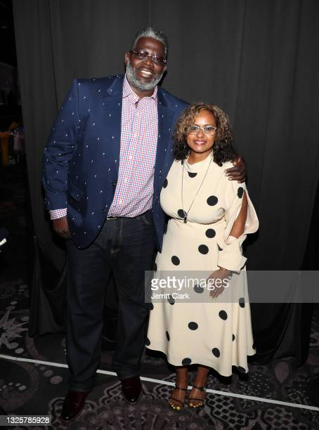 """Michael """"Blue"""" Williams and Shanti Das pose backstage at the Culture Creators Innovators & Leaders Awards at The Beverly Hilton on June 26, 2021 in..."""