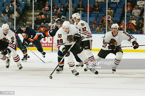 Michael Blunden of the Chicago Blackhawks skates with the puck against the New York Islanders during the game on October 31, 2006 at Nassau Coliseum...