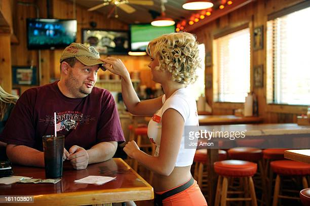 Michael Boling 37 of Broomfield talks with one of his favorite Hooters girls, Sammy Williams at his favorite hang out. Boling who has a ruptured a...