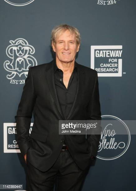 Michael Bolton poses for photos on the red carpet before the 3rd annual Vino con Stelle Gateway for Cancer Research event at Gemini Hangar on April...