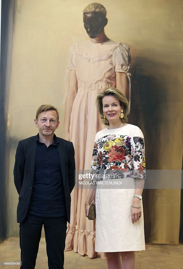 Michael Borremans and Queen Mathilde of Belgium pose during a visit to the exhibition 'As sweet as it gets' of Belgian artist Michael Borremans in Bozar centre for fine arts in Brussels, on May 27, 2014.