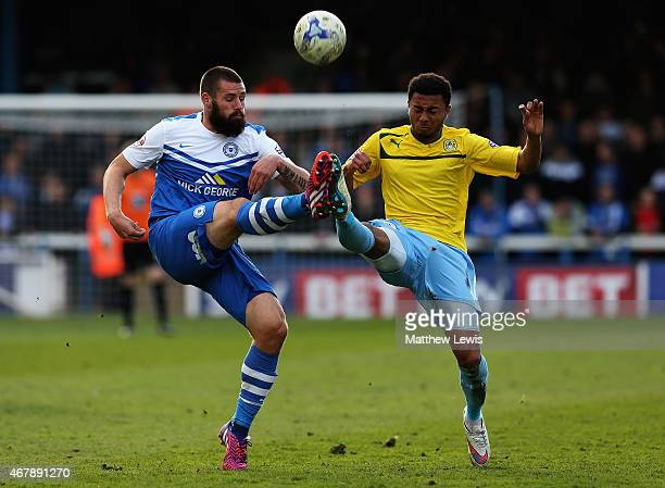 Michael Bostwick of Peterborough United and Grant Ward of Coventry City challenge for the ball during the Sky Bet League One match between...