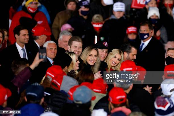 Michael Boulos, Vice President Mike Pence, Tiffany Trump, Eric Trump, Lara Trump, Jared Kushner, Ivanka Trump and Donald Trump Jr. Listen to US...