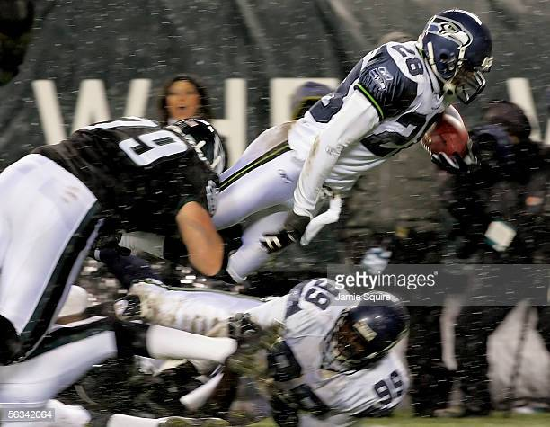 Michael Boulware of the Seattle Seahawks leaps into the endzone to score a touchdown in the second quarter of the game against the Philadelphia...