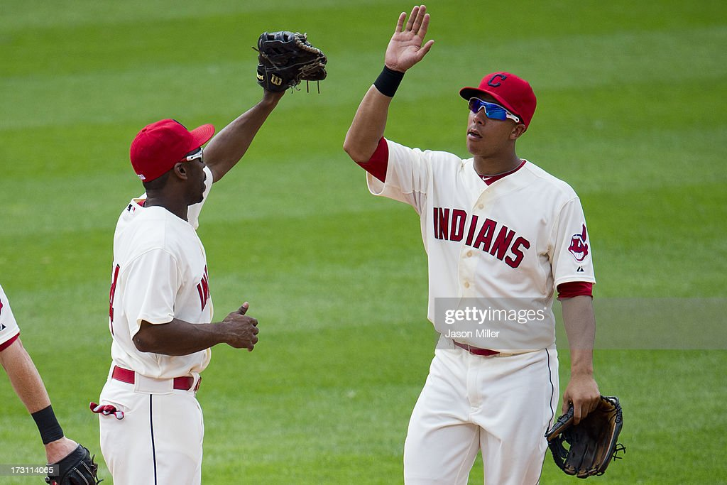 Michael Bourn #24 celebrates with Michael Brantley #23 of the Cleveland Indians after the Indians defeated the Detroit Tigers at Progressive Field on July 7, 2013 in Cleveland, Ohio. The Indians defeated the Tigers 9-6.