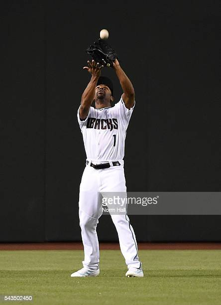 Michael Bourn of the Arizona Diamondbacks catches a fly ball off the bat of Carlos Ruiz of the Philadelphia Phillies during the second inning at...
