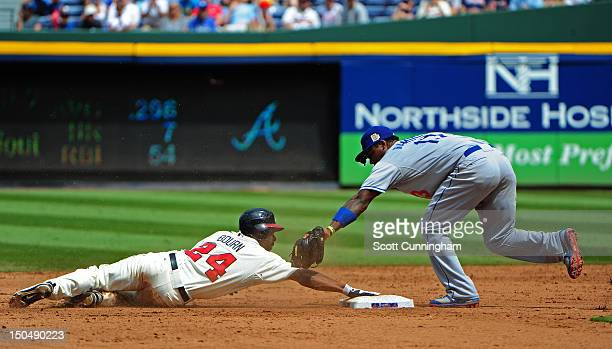 Michael Bourn of the Atlanta Braves steals second base against Hanley Ramirez of the Los Angeles Dodgers at Turner Field on August 19 2012 in Atlanta...