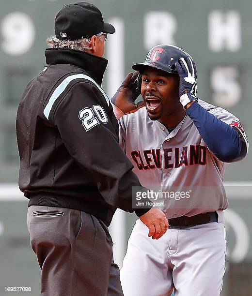 Michael Bourn of the Cleveland Indians pleads his case after umpire Tom Hallion called him on on a steal attempt against the Boston Red Sox in the...