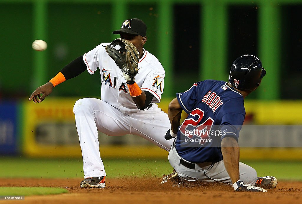 Michael Bourn #24 of the Cleveland Indians steals second as Adeiny Hechavarria #3 of the Miami Marlins fields the throw during a game at Marlins Park on August 3, 2013 in Miami, Florida.
