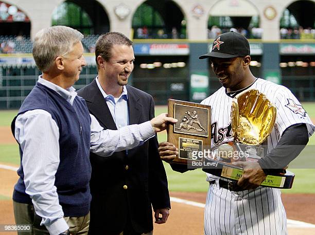 Michael Bourn of the Houston Astos receives from Houston Astros general manager Ed Wade left his Lou Brock Award for most stolen bases in the...