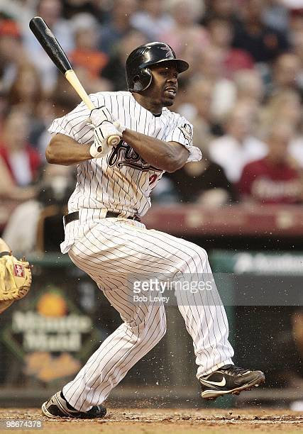 Michael Bourn of the Houston Astros singles on a ground ball to second baseman Akinori Iwamura of the Pittsburgh Pirates as the balll was deflected...