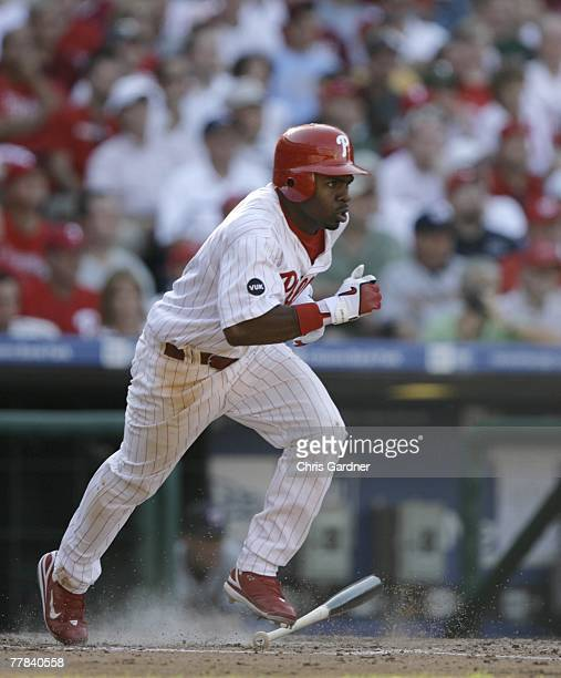 Michael Bourn of the Philadelphia Phillies drops his bat and runs toward first base against the Washington Nationals at Citizens Bank Park September...